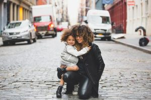 Young mother and daughter in city
